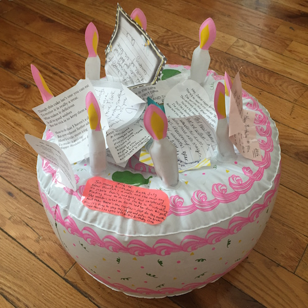 inflatable birthday cake with paper icing