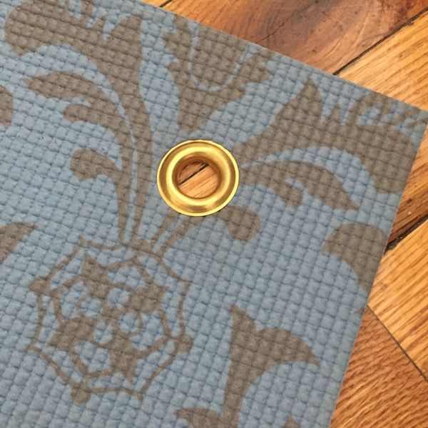 Grommets in a yoga mat? Yes please.